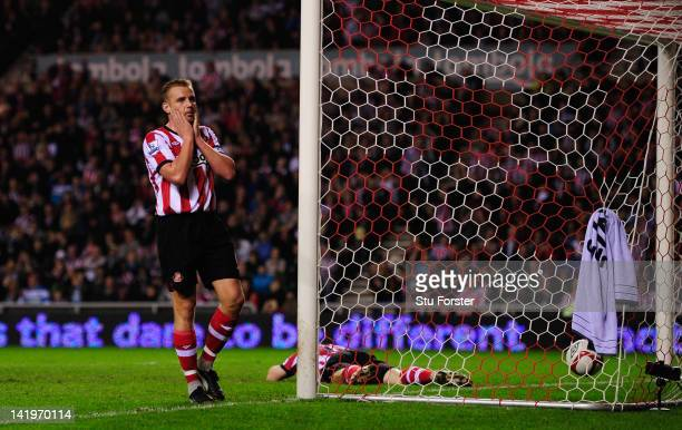 Sunderland player Lee Cattermole looks on dejectedly after teammate David Vaughan scores an own goal during the FA Cup Sixth Round Replay between...