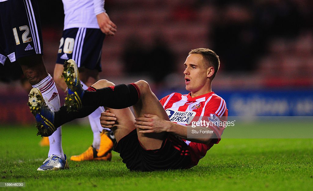 Sunderland player <a gi-track='captionPersonalityLinkClicked' href=/galleries/search?phrase=Matthew+Kilgallon&family=editorial&specificpeople=644779 ng-click='$event.stopPropagation()'>Matthew Kilgallon</a> looks on dejectedly after a miss during the FA Cup Third Round Replay between Sunderland and Bolton Wanderers at Stadium of Light on January 15, 2013 in Sunderland, England.