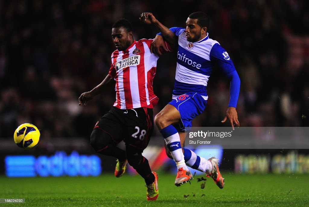 Sunderland player Stephane Sessegnon (l) brushes aside the challenge of Adrian Mariappa on his way to scoring the third Sunderland goal during the Barclays Premier League match between Sunderland and Reading at Stadium of Light on December 11, 2012 in Sunderland, England.