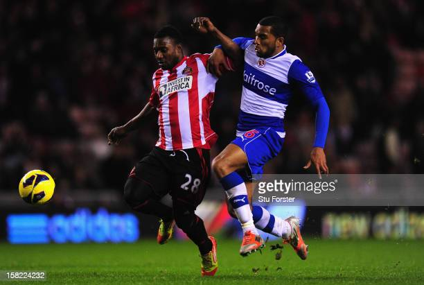 Sunderland player Stephane Sessegnon brushes aside the challenge of Adrian Mariappa on his way to scoring the third Sunderland goal during the...