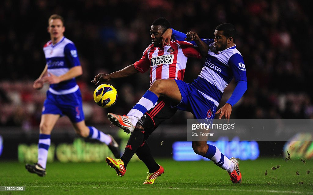 Sunderland player Stephane Sessegnon (l) brushes aside the challenge of <a gi-track='captionPersonalityLinkClicked' href=/galleries/search?phrase=Adrian+Mariappa&family=editorial&specificpeople=661604 ng-click='$event.stopPropagation()'>Adrian Mariappa</a> on his way to scoring the third Sunderland goal during the Barclays Premier League match between Sunderland and Reading at Stadium of Light on December 11, 2012 in Sunderland, England.