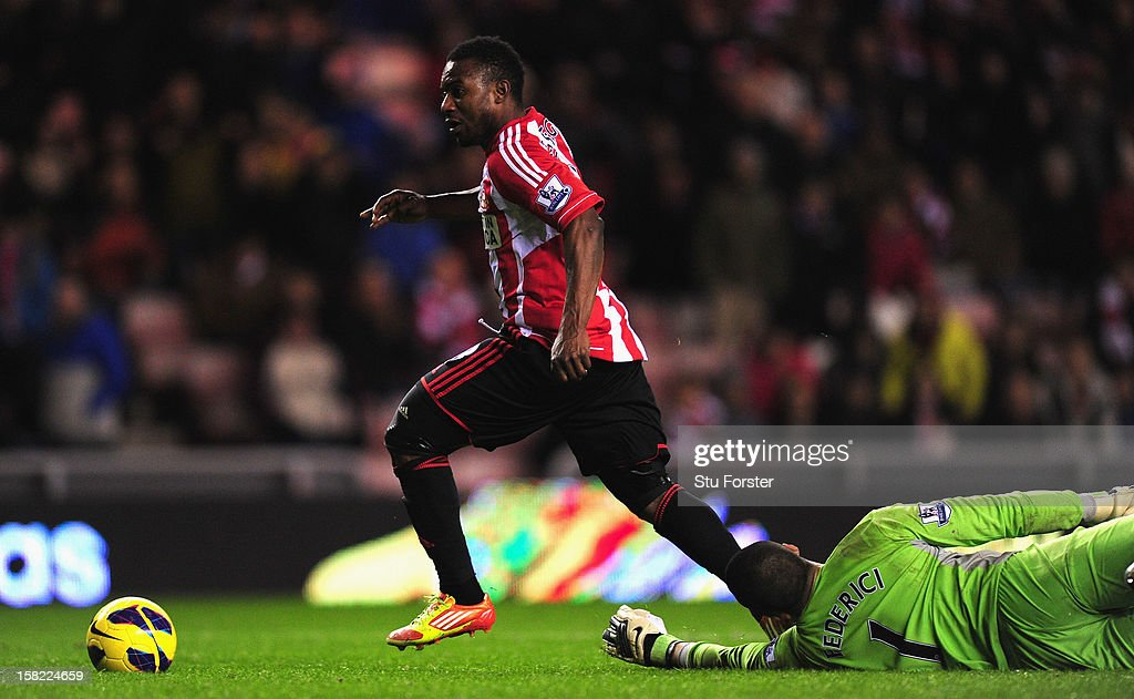 Sunderland player Stephane Sessegnon (l) rounds Reading keeper Adam Federici on his way to scoring the third Sunderland goal during the Barclays Premier League match between Sunderland and Reading at Stadium of Light on December 11, 2012 in Sunderland, England.