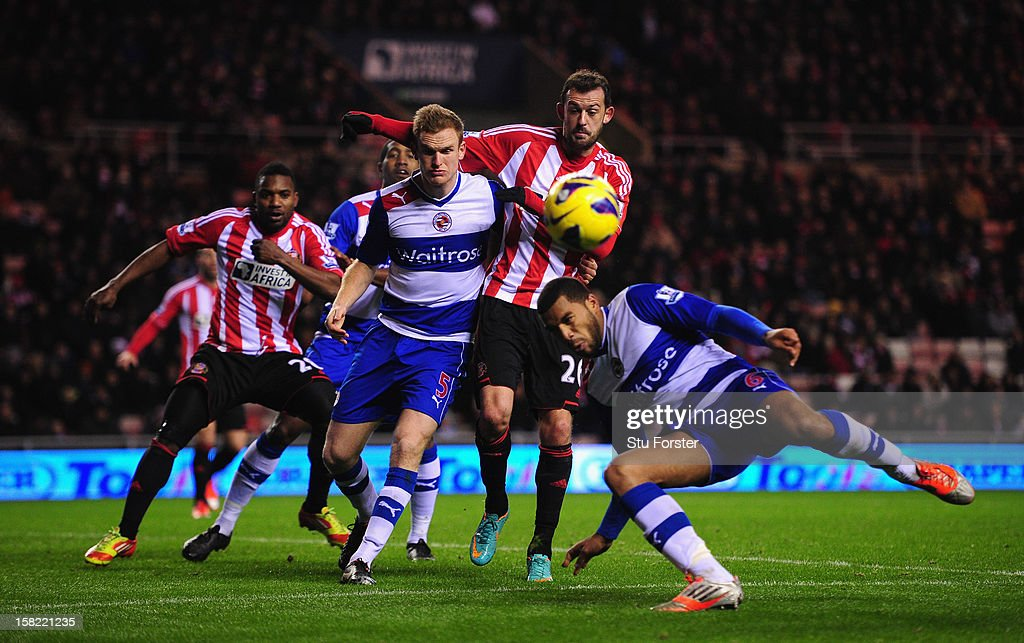 Sunderland player Steven Fletcher (c) causes havoc amongst the Reading defence during the Premier League match between Sunderland and Reading at Stadium of Light on December 11, 2012 in Sunderland, England.