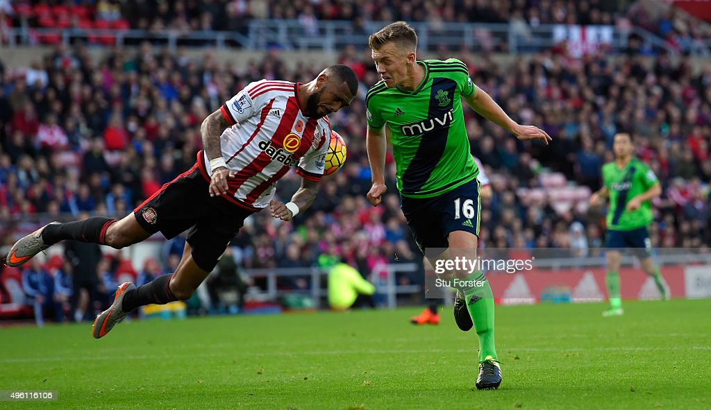 Sunderland player Yann M'vila (l) challenges James Ward-Prowse of Southampton during the Barclays Premier League match between Sunderland and Southampton at Stadium of Light on November 7, 2015 in Sunderland, England.