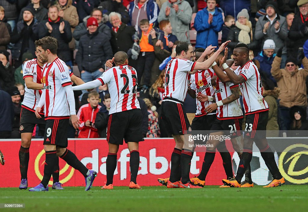 Sunderland players celebrate after Lamine Kone (R) headed the second Sunderland goal during the Barclays Premier match between Sunderland and Manchester United at the Stadium of Light on February 13, 2016 in Sunderland, England.