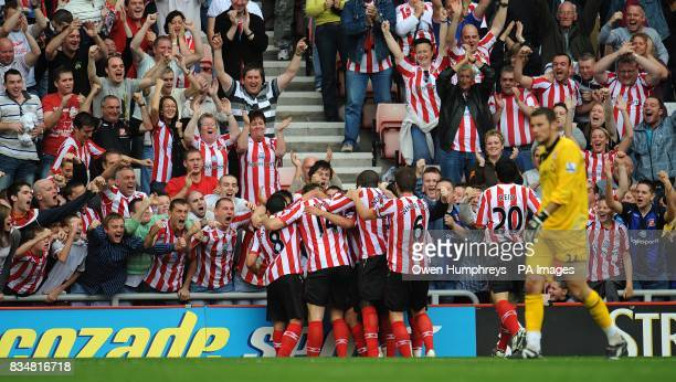 Sunderland players celebrate Michael Chopra's goal in front of their fans