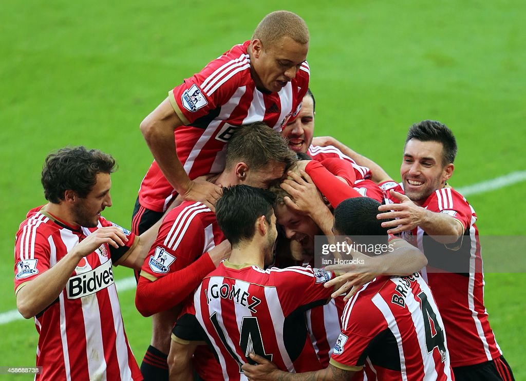 Sunderland players celebrate their goal during the Barclays Premier League match between Sunderland and Everton at the Stadium of Light on November 09, 2014 in Sunderland, England.