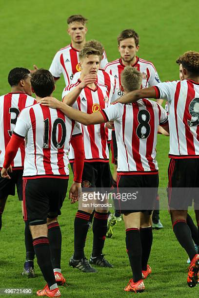 Sunderland players swamp Martin Smith of Sunderland after he scores the winning goal from the penalty spot during the Barclays Premier League...