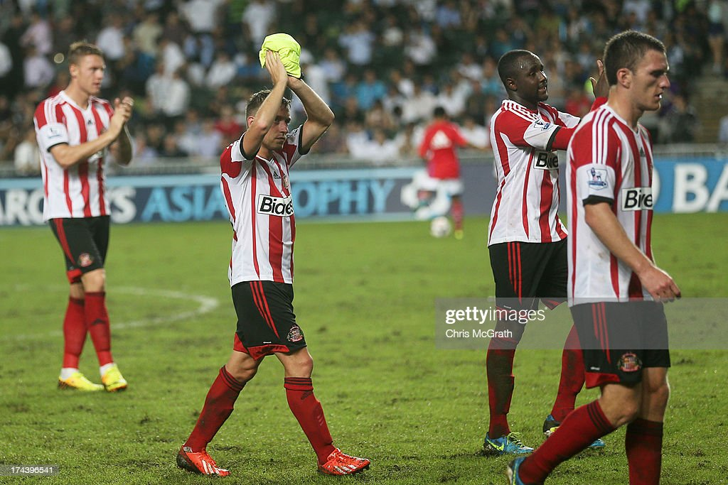 Sunderland players wave to the crowd during the Barclays Asia Trophy Semi Final match between Tottenham Hotspur and Sunderland at Hong Kong Stadium on July 24, 2013 in So Kon Po, Hong Kong.