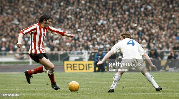 Sunderland striker Ian Porterfield runs at Billy Bremner of Leeds United during the 1973 FA Cup Final which Sunderland won with a goal from...