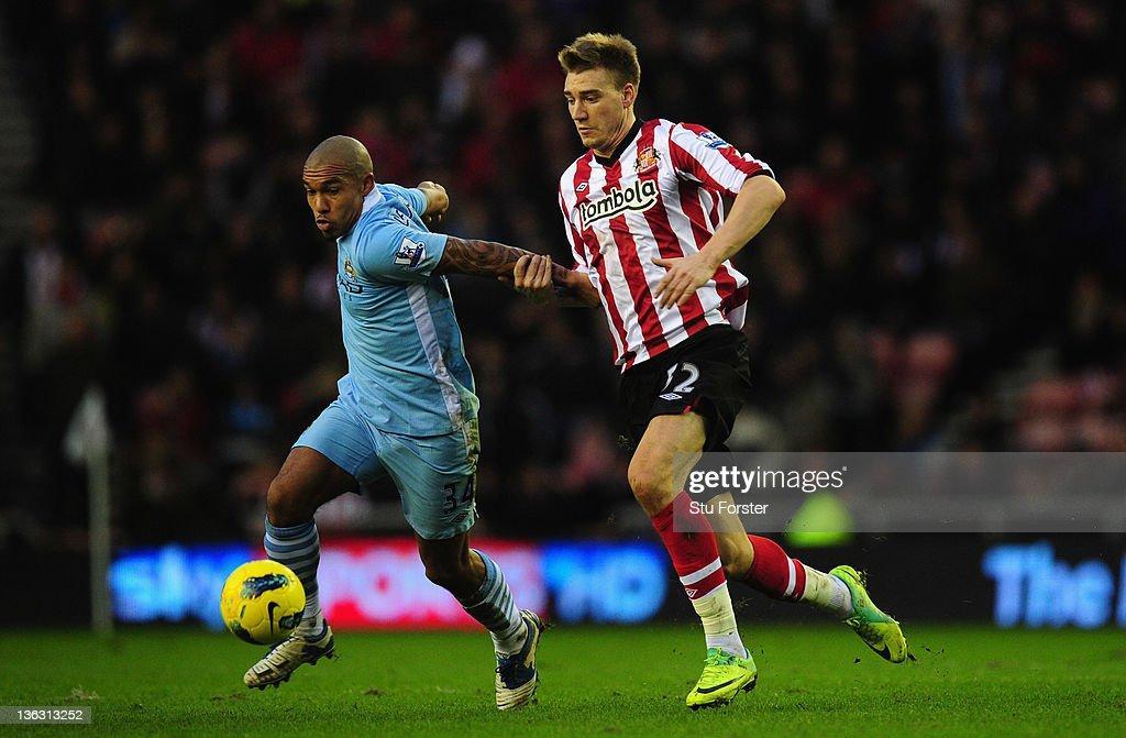 Sunderland striker Nicklas Bendtner battles with City player Nigel De Jong during the Barclays Premier League match between Sunderland and Manchester...