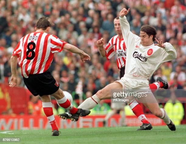 Sunderland striker Richard Ord attempts a ball past Liverpool's Jamie Redknapp at Roker Park today Pic Owen Humphreys/PA
