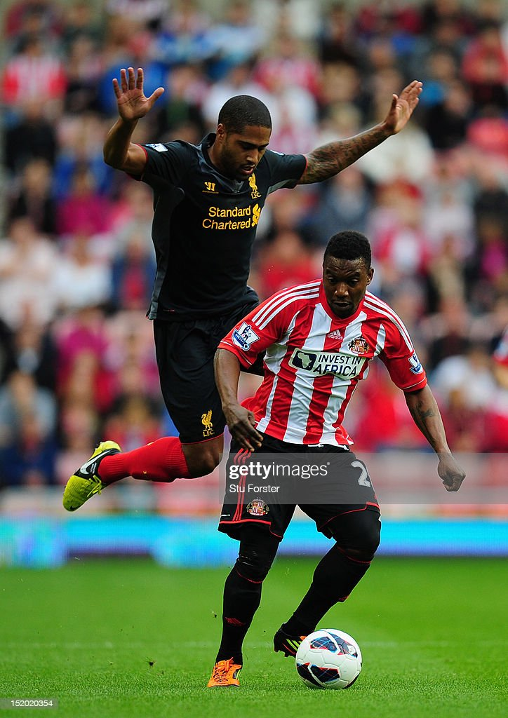 Sunderland striker Stephane Sessegnon beats Glen Johnson to the ball during the Barclays Premier league match between Sunderland and Liverpool at Stadium of Light on September 15, 2012 in Sunderland, England.