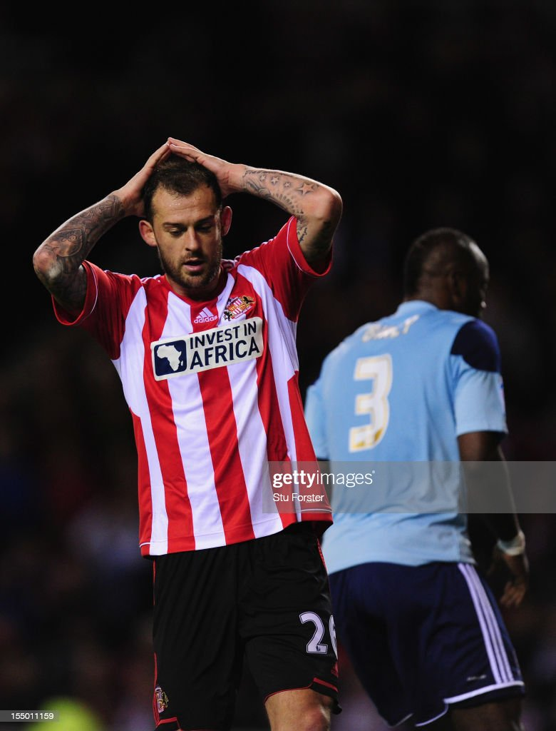Sunderland striker Steven Fletcher (l) reacts after another Sunderland miss during the Capital One Cup Fourth Round match between Sunderland and Middlesbrough at Stadium of Light on October 30, 2012 in Sunderland, England.