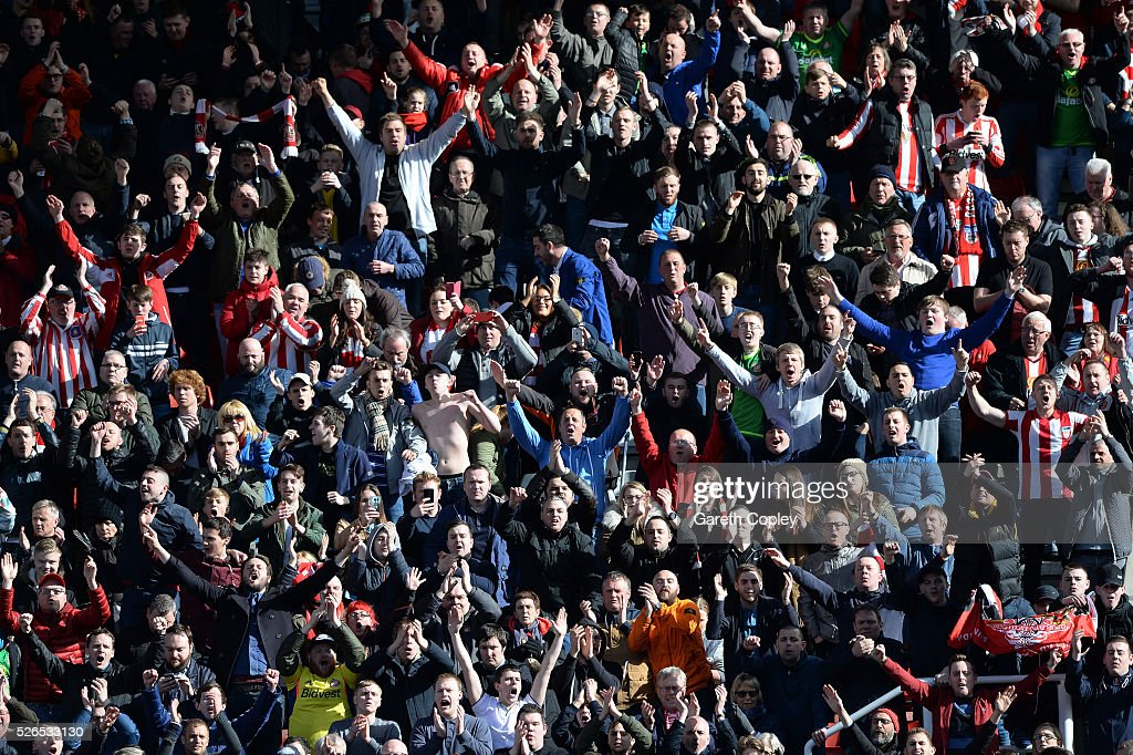 Sunderland supporters cheer after the Barclays Premier League match between Stoke City and Sunderland at the Britannia Stadium on April 30, 2016 in Stoke on Trent, England.