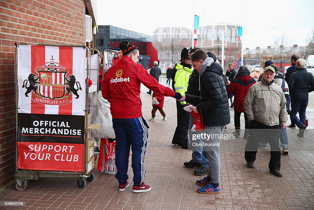 Sunderland supporters purchase at a stall prior to the Barclays Premier League match between Sunderland and Manchester United at the Stadium of Light on February 13, 2016 in Sunderland, England.