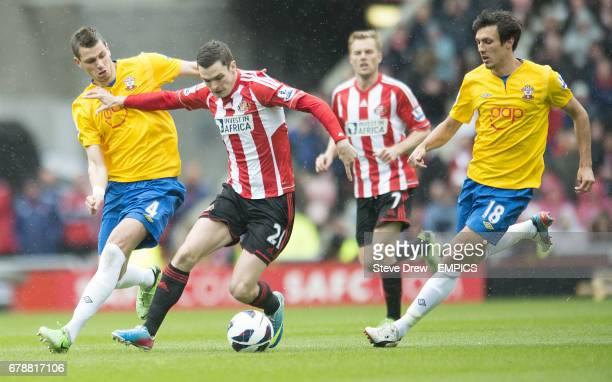Sunderland's Adam Johnson and Southampton's Morgan Schneiderlin battle for the ball