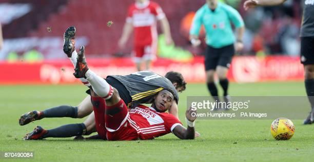 Sunderland's Adam Matthews lands on Middlesbrough's Britt Assombalonga after a challenge during the Sky Bet Championship match at Riverside Stadium...