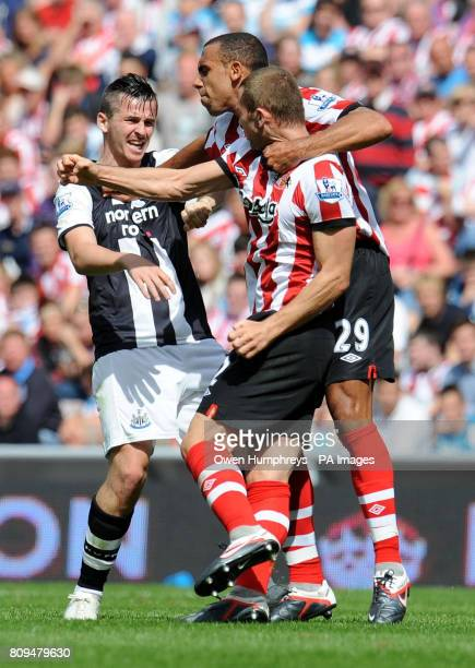 Sunderland's Anton Ferdinand holds back Newcastle's Joey Barton from Phil Bardsley during the Barclays Premier League match at the Stadium of Light...