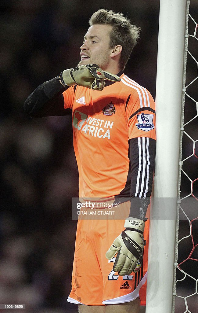 "Sunderland's Belgian goalkeeper Simon Mignolet gestures during the English Premier League football match between Sunderland and Swansea City at The Stadium of Light in Sunderland, north-east England on January 29, 2013. The game finished 0-0. USE. No use with unauthorized audio, video, data, fixture lists, club/league logos or ""live"" services. Online in-match use limited to 45 images, no video emulation. No use in betting, games or single club/league/player publications"