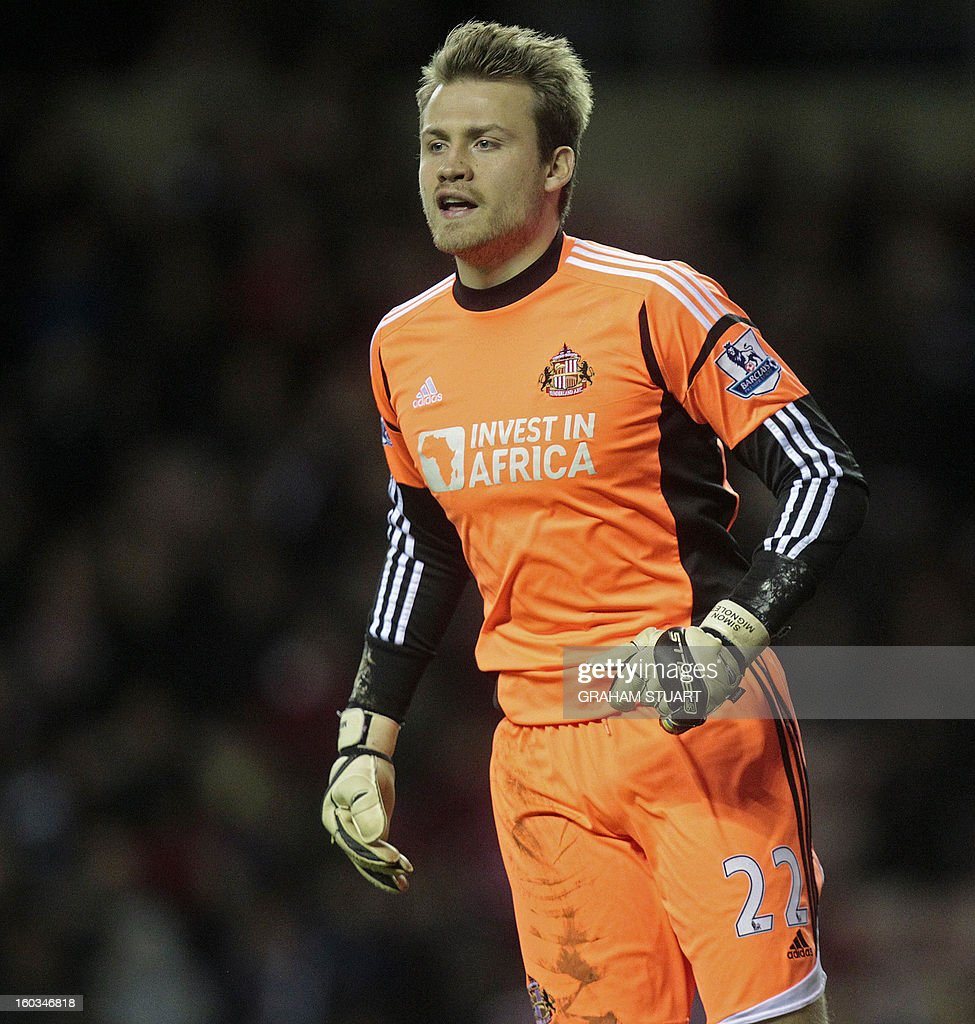 """Sunderland's Belgian goalkeeper Simon Mignolet looks on during the English Premier League football match between Sunderland and Swansea City at The Stadium of Light in Sunderland, north-east England on January 29, 2013. The game finished 0-0. USE. No use with unauthorized audio, video, data, fixture lists, club/league logos or """"live"""" services. Online in-match use limited to 45 images, no video emulation. No use in betting, games or single club/league/player publications"""