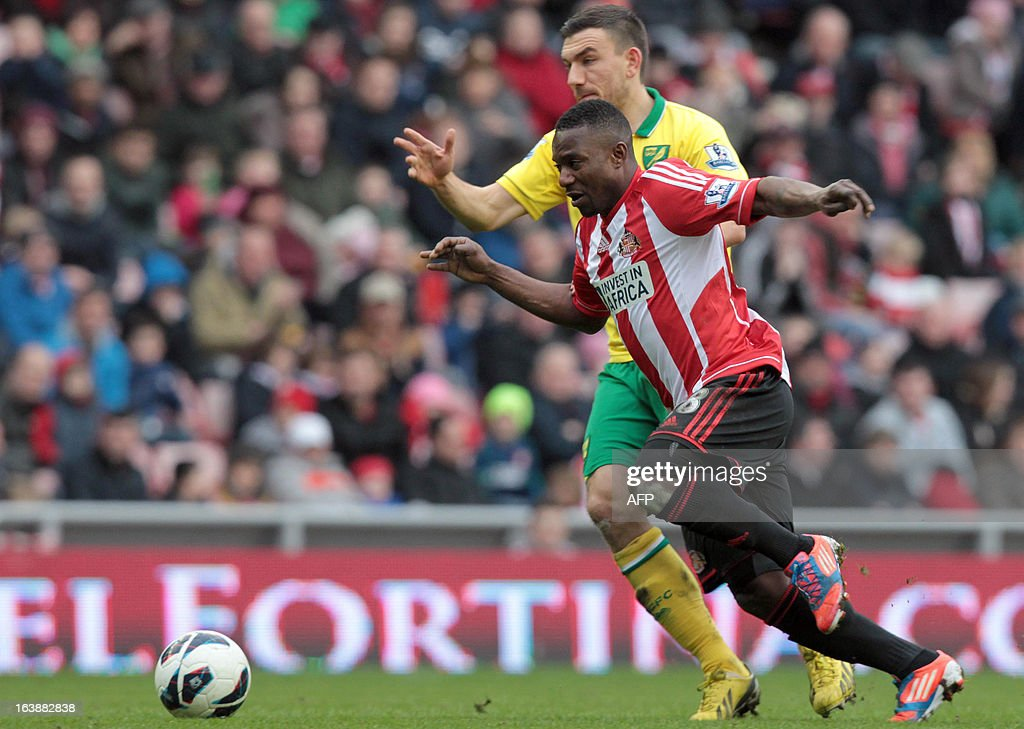 "Sunderland's Beninese midfielder Stephane Sessegnon (front) challenges Norwich's Scottish forward Robert Snodgrass during the English Premier League football match between Sunderland and Norwich City at The Stadium of Light in Sunderland, north-east England, on March 17, 2013. The match ended 1-1. USE. No use with unauthorized audio, video, data, fixture lists, club/league logos or ""live"" services. Online in-match use limited to 45 images, no video emulation. No use in betting, games or single club/league/player publications."