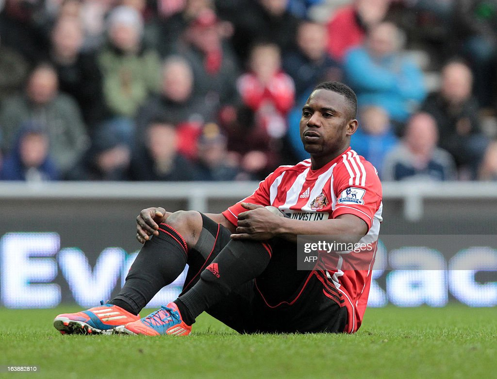 "Sunderland's Beninese midfielder Stephane Sessegnon reacts after missing Norwich's goal during the English Premier League football match between Sunderland and Norwich City at The Stadium of Light in Sunderland, north-east England, on March 17, 2013. The match ended 1-1. USE. No use with unauthorized audio, video, data, fixture lists, club/league logos or ""live"" services. Online in-match use limited to 45 images, no video emulation. No use in betting, games or single club/league/player publications."