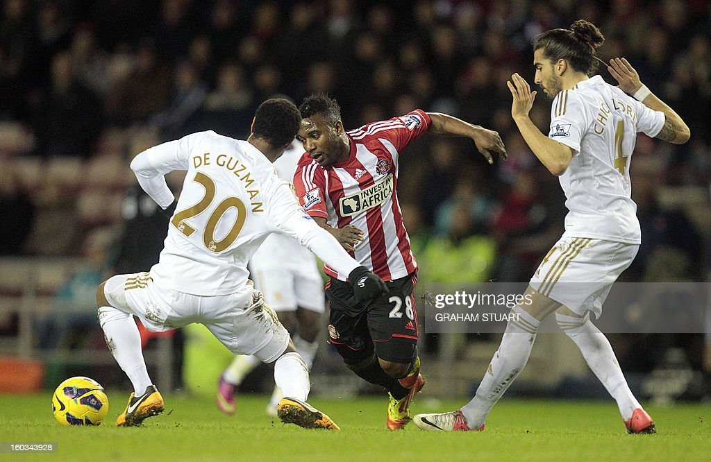 "Sunderland's Beninese midfielder Stephane Sessegnon (2nd L) vies with Swansea City's Canadian-born Dutch midfielder Jonathan de Guzman (L) and Spanish defender Chico Flores (R) during the English Premier League football match between Sunderland and Swansea City at The Stadium of Light in Sunderland, north-east England on January 29, 2013. USE. No use with unauthorized audio, video, data, fixture lists, club/league logos or ""live"" services. Online in-match use limited to 45 images, no video emulation. No use in betting, games or single club/league/player publications"
