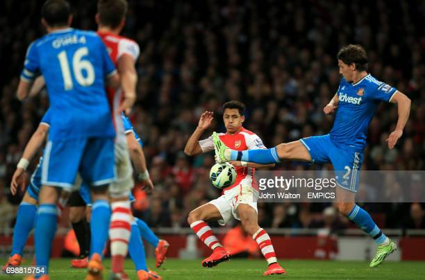 Sunderland's Billy Jones and Arsenal's Alexis Sanchez battle for the ball
