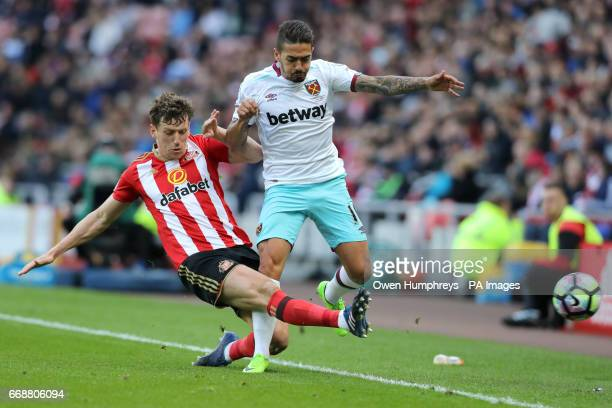 Sunderland's Billy Jones and West Ham United's Manuel Lanzini battle for the ball during the Premier League match at the Stadium of Light Sunderland