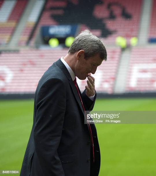Sunderland's chariman Ellis Short inspects the pitch before the Barclays Premier League match between Sunderland and Reading is called off due to a...