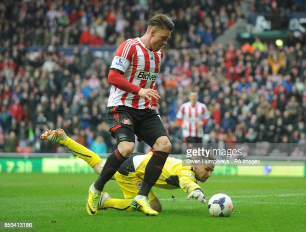 Sunderland's Connor Wickham goes around Cardiff's David Marshall during the Barclays Premier League match at the Stadium of Light Sunderland