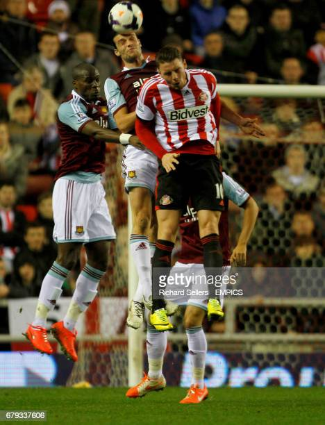 Sunderland's Connor Wickham is challenged by West Ham's Andy Carroll and Guy Demel