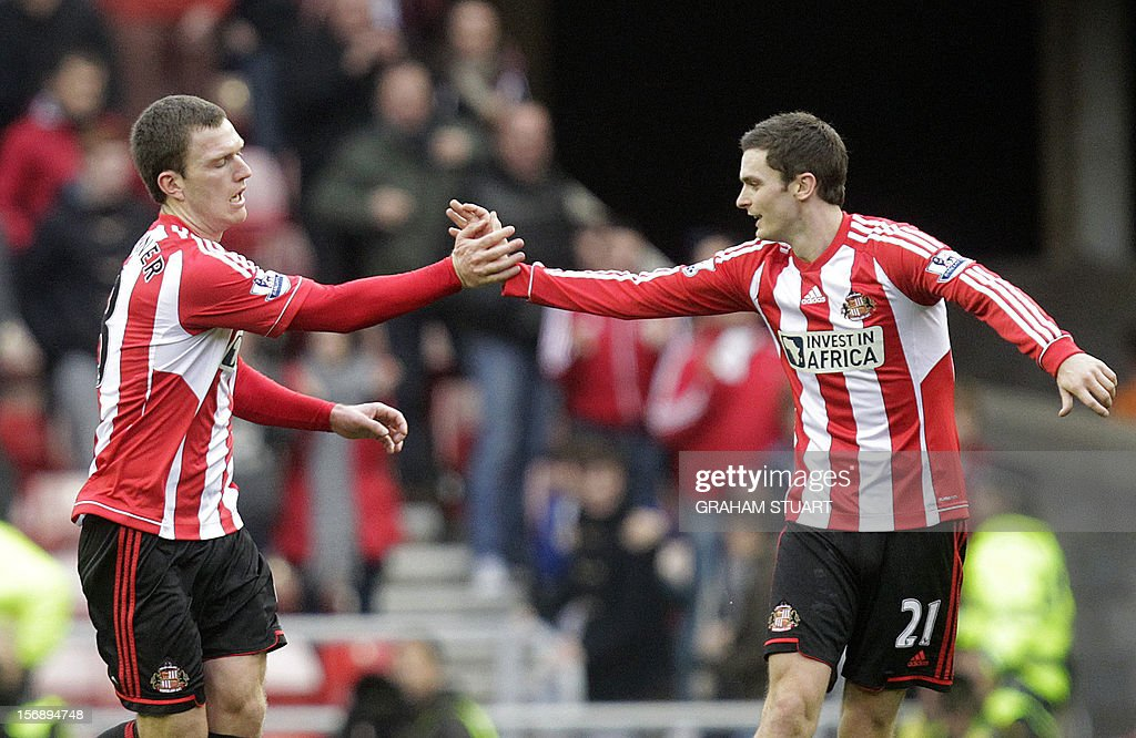 "Sunderland's Craig Gardner (L) celebrates with Adam Johnson after scoring their first goal against West Bromwich Albion during their English Premier League football match at the Stadium of Light in Sunderland, north-east England, on November 24, 2012. USE. No use with unauthorized audio, video, data, fixture lists, club/league logos or ""live"" services. Online in-match use limited to 45 images, no video emulation. No use in betting, games or single club/league/player publications"