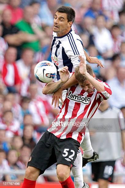 Sunderland's Danish striker Nicklas Bendtner vies with West Bromwich Albion's Austrian midfielder Paul Scharner during the English Premier League...