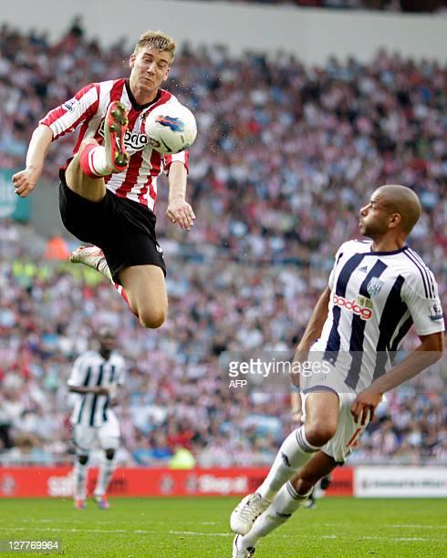 Sunderland's Danish striker Nicklas Bendtner vies with West Bromwich Albion's Irish midfielder Steven Reid during the English Premier League football...