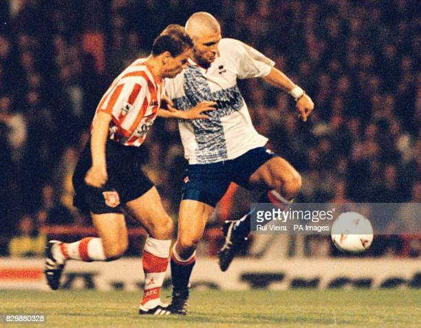 Sunderland's Dariusz Kubicki and Middlesbrough's Ravanelli go for the same ball during their FA Carlking Premiership match at Roker Park Sunderland...