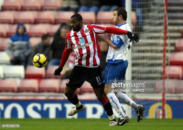 Sunderland's Darren Bent and Barrow's Mike Pearson