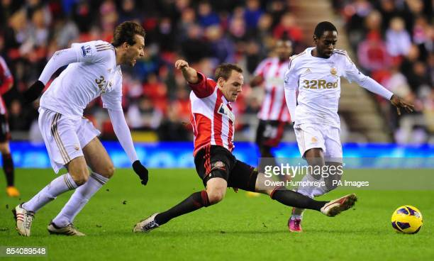 Sunderland's David Vaughan in action with Swansea's Miguel Michu and Nathan Dyer during the Barclays Premier League match at the Stadium of Light...