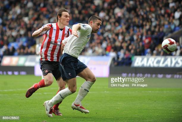 Sunderland's Dean Whitehead and Bolton Wanderers' Gary Cahill battle for the ball
