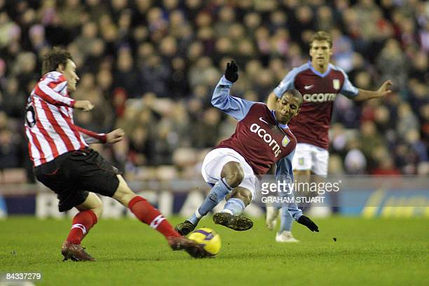 Sunderland's Dean Whitehead is tackled by Aston Villa's Ashley Young for which he was sentoff during their FA Premier League football match on...