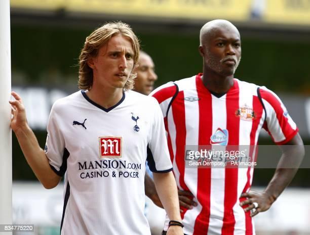 Sunderland's Djibril Cisse and Tottenham Hotspur 's Luka Modric await or a corner to be taken