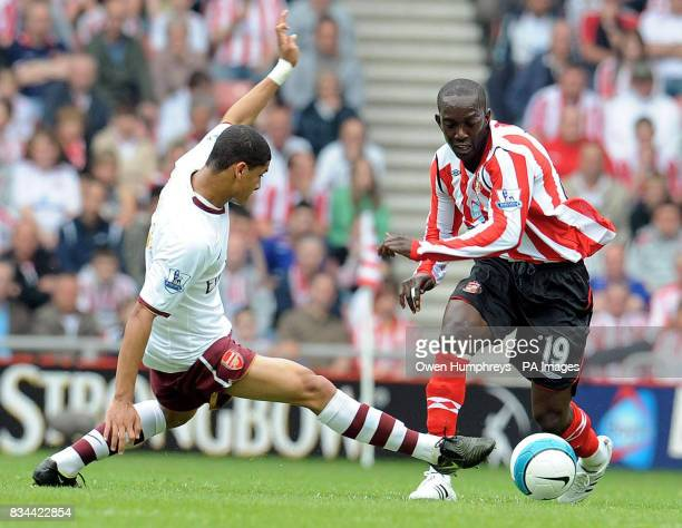 Sunderland's Dwight Yorke in action with Arsenal's Gael Clichy during the Barclays Premier League match at Stadium of Light Sunderland