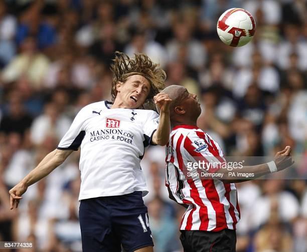 Sunderland's ElHadji Diouf and Tottenham Hotspur's Luka Modric battle for the ball