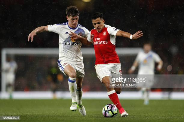Sunderland's English defender Billy Jones vies with Arsenal's Chilean striker Alexis Sanchez during the English Premier League football match between...