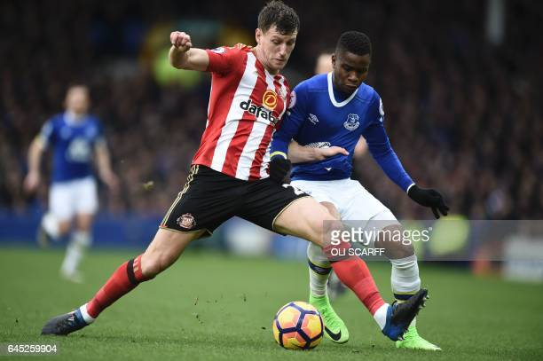 Sunderland's English defender Billy Jones vies with Everton's English striker Ademola Lookman during the English Premier League football match...