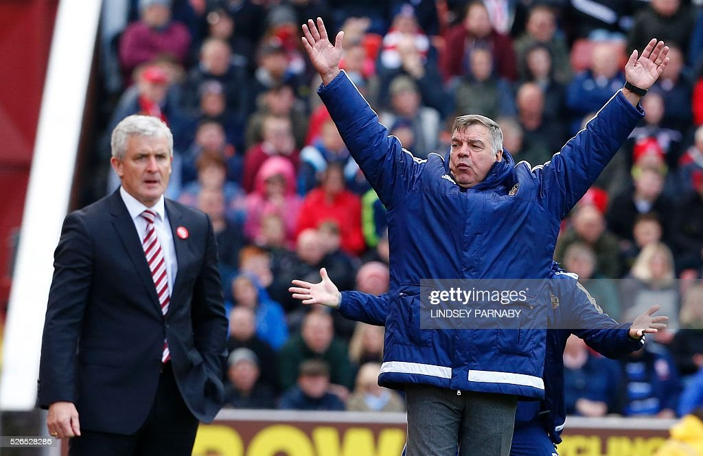 Sunderland's English manager Sam Allardyce (R) reacts next to Stoke City's Welsh manager Mark Hughes (L) as Sunderland are awarded a late penalty during the English Premier League football match between Stoke City and Sunderland at the Britannia Stadium in Stoke-on-Trent, central England on April 30, 2016. / AFP / LINDSEY PARNABY / RESTRICTED TO EDITORIAL USE. No use with unauthorized audio, video, data, fixture lists, club/league logos or 'live' services. Online in-match use limited to 75 images, no video emulation. No use in betting, games or single club/league/player publications. /