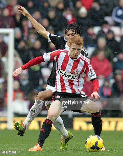 Sunderland's English midfielder Jack Colback vies with Southampton's English midfielder Jack Cork during the English Premier League football match...