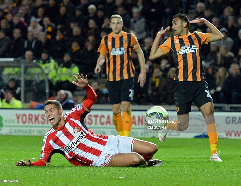Sunderland's English midfielder Jack Rodwell is booked for this adjudged dive during the English Premier League football match between Hull City and...