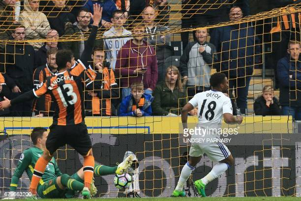 Sunderland's English striker Jermain Defoe turns to celebrate after scoring their second goal past Hull City's Swiss goalkeeper Eldin Jakupovic...